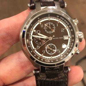Women's embossed brown leather Michael Kors watch.